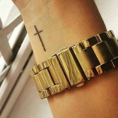 Pin for Later: 50 of the Most Popular Tattoo Designs For Chic Women Cross