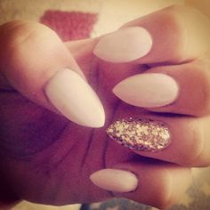 Nude acrylic nails with gold ring finger.. Point is very on trend and nude is perfect for everyday!