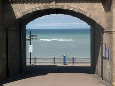 Perfectly stone framed view of the sea at Sheringham, Norfolk, UK