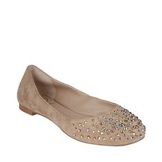 This makes me think, 'could I get some plain shoes at Good Will and glue some bling on them?'