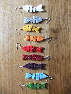Felt Skeleton/Bones Fish Earrings (I don't like the fish, but this inspires thought of other Skelton jewelry in felt: DOTD, Kitties, Etc...) (Inspiration Only. No Pattern or Instructions.)