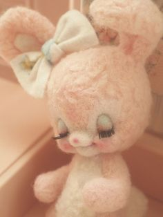 Vintage style bunny with closed eyes & eyelashes. So adorable! The face is perfect and I love the bow on the bunny's ear.
