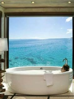bathtub overlooking the ocean (or lake, river, pool)...would be nice to be able to open window