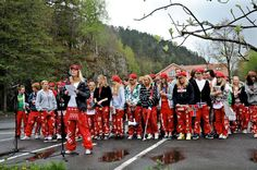 Graduating high school seniors take to the streets in mai wearing red pants...The Russ!
