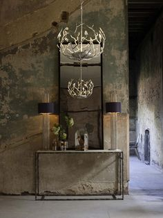Porta Romana Mirror, Console, Chadelier, and Table Lamps