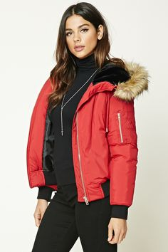 A padded woven jacket featuring a faux fur-lined drawstring hood, zipper front, long sleeves, a zipper sleeve pocket, ribbed trim, and a quilted interior. #F21HolidayContest