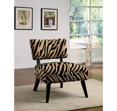This uniquely designed chair features an extra-wide seat wrapped in an exquisite micro velvet fabric on top of wooden legs in a rich, walnut finish.