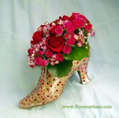 clever floral arrangement in a shoe! #ValentinesDay Very creative. Vintage look. Cute decoration for a bridal shower or #ValentinesDay party