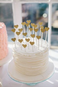 Heart cake toppers | Photo by Sylvia Photography | Read more - www.100layercake…. For more wedding inspiration check out our wedding blog www.creativeweddingco.com