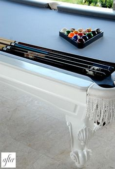 painting the pool table and re-felting it could make it look REALLY cool!