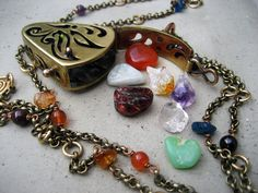 Butterfly Locket with seven stones to adjust one's Chakra.  SilviasCreations $390.00, via Etsy.