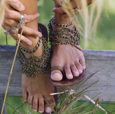 Like the design. Te strap one the toe & a portion of the band could be permanent to the base of the sandal, and the rest of it is completely customizable & interchangeable. Easy to us the same base for many different designs.