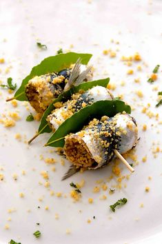 Sarde a beccafico - a traditional Sicilian dish using fresh sardines that are stuffed, rolled and baked