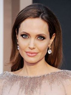 Angelina Jolie soft, brown smoky eye with pink lipstick and glowing skin | allure.com