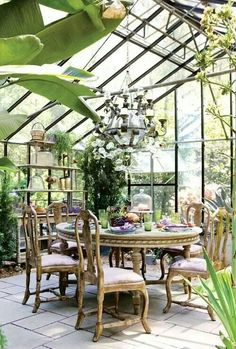 Id love a greenhouse done like this that you could sit in & enjoy :)