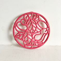 Fabulous Hot Pink Enameled Cast Iron TrivetA must have vintage kitchen item, made even more special in a rare shade of hot-pink. These beautifully designed trivets are always a conversation piece as they look so lovely just propped up against the backsplash when not in use. Decorative yet incredibl