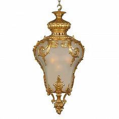 An extraordinary and rare French 19th century Louis XV st. ormolu and frosted glass lantern. The large lantern is centered by an exquisitely chased, 'Flame Eternelle' (flame of prosperity), ormolu bottom inverted finial with scrolled mounts and rich blossoming flowers. Leading up each side are rich foliate ormolu movements and finely detailed acanthus leaves encasing the frosted glass which houses four light bulbs lighting up the whole with a warm inviting glow. The impressive pierced top…