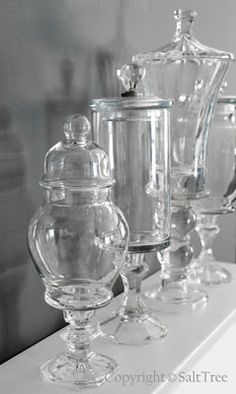 DIY:  How To Make Apothecary Jars - using thrifted glassware, hardware and glue. This is a clever way to decorate your space. Via Salttree.net