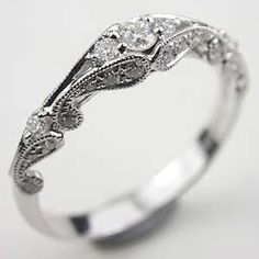 This will replace my boring ol wedding band! Swirling Diamond Wedding Band-- paired with a simple and dainty engagment ring. Wedding Rings Vintage, Vintage Engagement Rings, Vintage Rings, Vintage Style, Solitaire Engagement, Vintage Diamond, Vintage Beauty, Intricate Engagement Ring, Unique Vintage