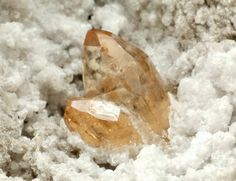 Topaz, Wah Wah Mountains Beaver County, Utah, USA Sharply formed, gem, terminated and very lustrous crystals of topaz in intensive champagne colour on ryolite matrix.