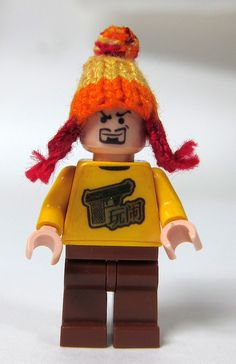 "How tiny is the tiniest, shiniest Jayne hat? Made by Lauren B. with ""crochet thread, 000 sized needles, & a lot of patience"" for brickfrenzy's minifig Jayne 