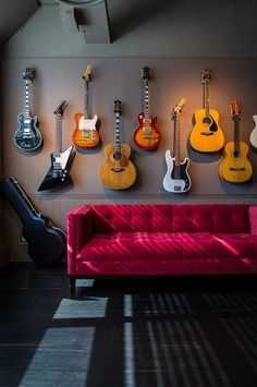 Unique Ways to Display Collections   Guitars staggered (I have a feeling this is what our house is going to look like soon)