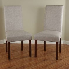 This set of two dark walnut linen dining chairs will instantly elevate your dining space. The comfortable polyester blend fabric and sand colored cushions will coordinate with any color scheme. Modern lines make this set ideal for any home environment.