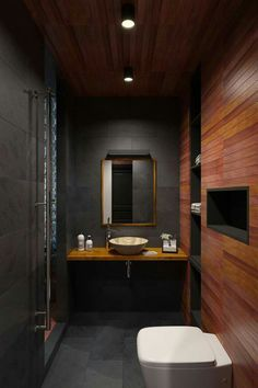 Turning a tiny apartment into a functional and aesthetic bachelor pad, Perhushkovo is one of those smart urban settings where every inch of space ma . Dark Wood Bathroom, Teak Bathroom, Bathroom Interior, Modern Bathroom, Small Bathroom, Bathroom Ideas, Apartment Interior, Loft Bathroom, Shiplap Bathroom