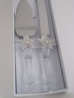 Rhinestone  Snowflake  Winter  Wonderland  cake  server  set - $19.95  per  set.  Faux  crystal  and  stainless  steel  cake  server  set  hand  decorated  with  rhinestone  Snowflakes. This  cake  server  set  sparkles  in  the  sunlight  of  a  Winter  Wonderland  wedding. For  more  info  please  contact - Shoot  for  the  Moon  Jewelry  Designs (850) 230-9983 #winterweddings #cakeservers #snowflakes #winterweddingideas