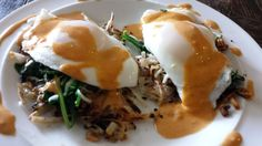 Hashbrown Benedict snuggling baby spinach and baby bok choy topped with a homemade lemon-chipotle habanero hollandaise.