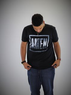 "Christian Clothing for Men (AMEN Tee) - The word AMEN, translated from it's Hebrew form, simply means ""so be it"". This simple yet powerful declaration points to one truth - God is in control. We are able to say, ""so be it"", because we are confident that the God we serve works all things for our favor - whether good or bad. Can we get an AMEN? If so, wear what you believe today!  Model Height : 5' 10"" Model Size : L"