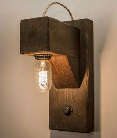 "Reclaimed 4"" wood beams are wired wired with 6 Edison style light bulbs, then hung with hand forged iron hardware and heavy duty chains."