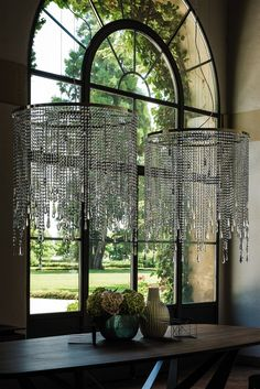 A luxury glass ceiling light designed as a modern style chandelier. Also a Floor, Table and Wall Light.