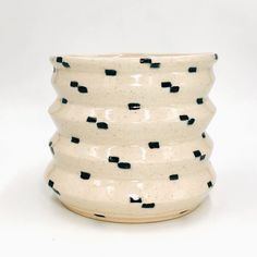 "Large ""Dalmatian"" Planter by Independent Ceramic Artist, Jackie Wang Hand-made clay planter by Brooklyn-native, Jacqueline Wang. Comes with catchall.About Jackie Wang - Brooklyn native Jackie Wang is a graphic designer by day and clay addict by night."