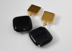 These Designs by s.e.K geometric earrings each feature gold plated squares with blue goldstone.