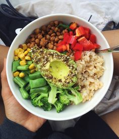 brown rice, steamed broccoli, beans + corn, lentils, red capsicum and dukkah coated avocado on top of a bed of baby spinach