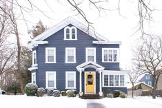 This historic beauty looks fantastic in the snow with its blue exterior and sunny yellow door Navy House Exterior, Colonial House Exteriors, Exterior Door Colors, White Exterior Houses, Exterior Paint, Light Blue Houses, Navy Houses, Best Front Door Colors, Best Front Doors