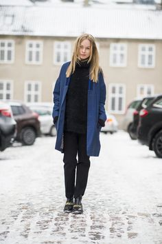 All black, coupled with a printed blue coat and minimalist chain-adorned booties might be the quickest way to a chic Winter style moment.