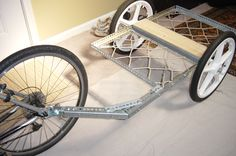 Instructions on how to build a tough and light bicycle trailer out of standard light gauge angle iron found at the hardware store. This design is tough, relatively...