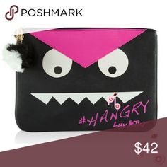 "🔻1 DAY SALE | Clutch Bag / Tablet Case The Hangry bag from LUV Betsey by Betsey Johnson features a pink/black PU leather, fully lined interior, and secure top zip closure. It's big enough to fit any tablet.  * Pouch/Clutch Bag * Width: 12.5"" x Height: 9"" x Depth: 1"" * PU leather * Accessorized with Pom Pom. * Fully lined interior * Pink & Black * Secure top-zip closure Betsey Johnson Bags Clutches & Wristlets"