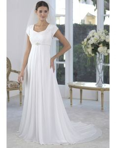 Delicate beading emphasizes the empire waist of this gown and the flowing chiffon skirt.   Petals and Promises Bridal