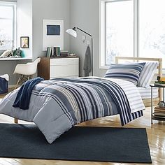 Give your space a contemporary update with the stylishly smart Cruz Comforter Set. Boasting modern stripes in cool blue and neutral hues, this sophisticated set will give your bedroom or dorm room a sleek and polished look.