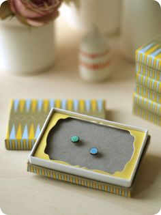 Decorate your ears with these Spring pretties! Available in mixed combinations of Emerald, Coral, Lemon, and Cornflour Blue both in plain enamel or striped. Comes beautifully packaged in our signature box.