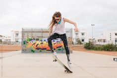 Woman Jumping With a Skateboard in a Skate Park by killer | Stocksy United