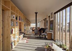 Nakai House made of recycled materials for $25,000 in Utah. A study in efficiency in both energy use and space, the home is defined by a 50'-long bookshelf separating an open space for working and entertaining visitors the more private living spaces.