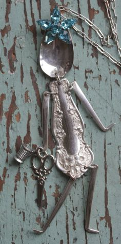 Little ladies made from spoons. I know it's jewelry, but it could be a cute wind chime?
