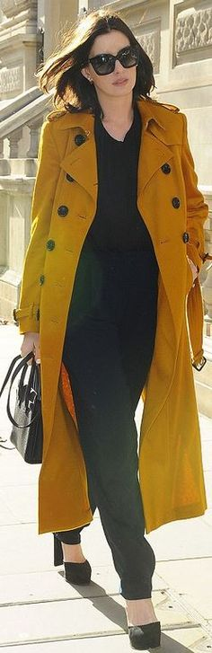Who made Anne Hathaway's yellow trench coat, sunglasses, and black tote handbag?