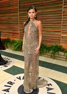 Selena Gomez opted for gold in an Emilio Pucci embroidered tulle halter-neck dress from the Fall 2014 collection.