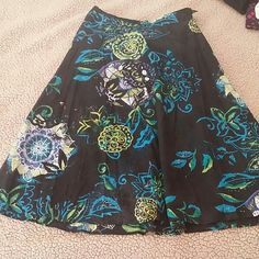 Long flowing skirt from Chicos Fully lined! Comes just above my ankle at 5'4. Sz 0 which is like a 2 or 4 in other brands.  Such a beautiful fun skirt! Not too excited to sell it... but need to clean out my closet! Chico's Skirts A-Line or Full