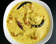 Punjabi Kadhi Pakora is a spicy sour yogurt and gram flour (besan) based curry with crispy fried vegetable Pakoras simmered in the curry.
